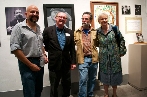 "Over a hundred people turnout out for the opening of the ""Stetson Kennedy:A Life of Purpose"" exhibit at the Cofrin Arts Center on the Oak Hall School campus at 8009 SW 14th Ave. on Jan. 11. From left to right: Robert Ponzio, Oak Hall Art Department Head; Gary Bone,art teacher and gallery curator; Joe Courter from the Civic Media Center, which collaborated on the exhibit; and Sandra Park, former wife and head of the Stetson Kennedy Foundation. The gallery is open Monday through Friday, 8:30 a.m. to 4 p.m., and the show will run through Feb. 9. A showing of ""Soul of the People,"" which features Stetson Kennedy and the Federal Writers Project, will take place at the CMC on Monday evening, Jan. 21, at 7 p.m. Photo by Michelle Koehlmoos."